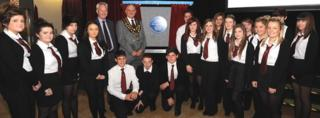 Pupils and dignitaries with the blue plaque
