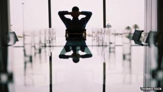 Silhouette of businessman in boardroom
