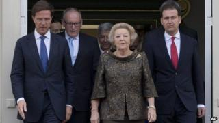 Prime Minister Mark Rutte (left) with Queen Beatrix and members of his government at the royal palace in The Hague on 5/11/12