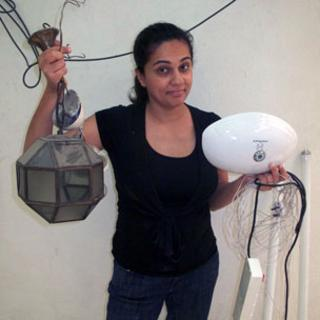 Anu Anand with light fittings