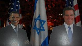 Cut outs of the two presidential contenders standing with the US and Israeli flags at an American embassy event in Tel Aviv