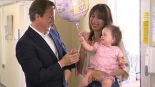 David and Samantha Cameron with Florence