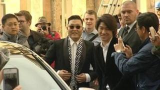 Psy arriving at the Oxford Union