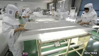 Solar panels being assembled at a factory in China