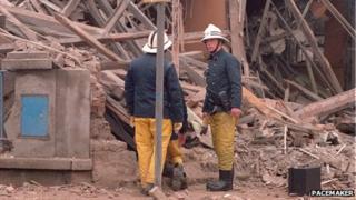 Fireman in front of rubble