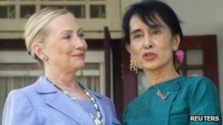US Secretary of State Hillary Rodham Clinton, left, standing together with pro-democracy leader Aung San Suu Kyi after their meeting in Yangon, Burma December 2011