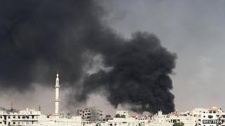 Smoke rises from the eastern Damascus suburbs of Arbeen, after what activists say was an air strike by a MIG fighter jet, 8 November 2012
