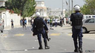 Bahraini police confront anti-government protesters in Diraz, west of Manama, on 9/11/12