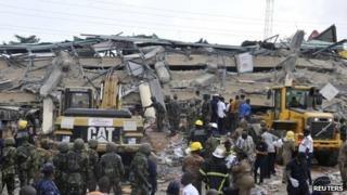 Rescuers at the collapsed building in Accra on 7 November.