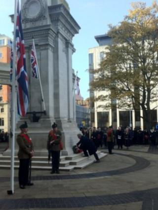 Eamon Gilmore laying a wreath in Belfast