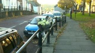 Flowers at the scene where Dean Laing was killed