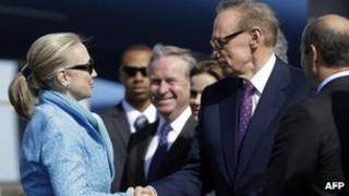 Hillary Clinton shakes hands with Australian Foreign Minister Bob Carr in Perth on 13 November 2012