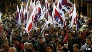 Demonstrators protest against austerity measures in Athens on Sunday