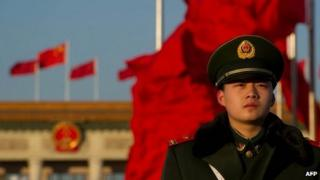 A paramilitary policeman stands before the Great Hall of the People before the closing ceremony of the Communist Party Congress in Beijing early on 14 November 2012