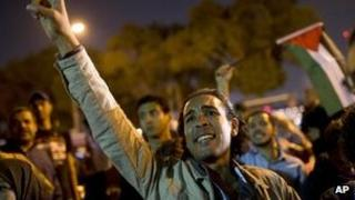 Egyptians chant slogans against latest Israel air strikes in Gaza during a protest in Cairo