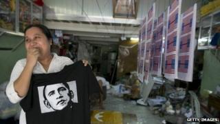 Kyu Kyu Mar, owner of Super silk screening shop, holds a T-shirt printed with an image of US President Barack Obama in Rangoon, Burma, 16 November 2012