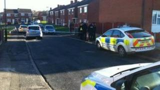 Police cars and cordon on a residential street