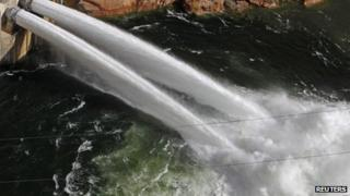Water pours from river outlet tubes during an experimental high flow release from the Glen Canyon Dam in Page, Arizona