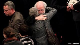 Archbishop of Canterbury Rowan Williams hugging a woman