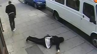 CCTV still of the girl on the floor after the attack