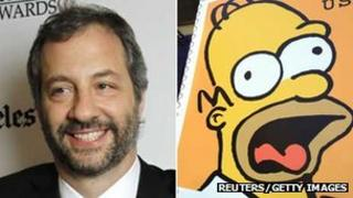 Judd Apatow and an enlarged stamp bearing the face of Homer Simpson