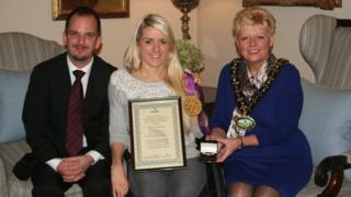 Powys council chairman Susan McNicholas presents a Gold Kite Award to Josie Pearson watched by councillor Gareth Ratcliffe