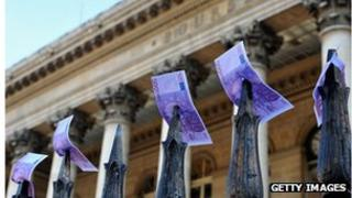 Fake euro notes placed by strikers on the gates outside the Paris Stock Exchange in November 2011