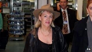Nadine Dorries arrives at Heathrow