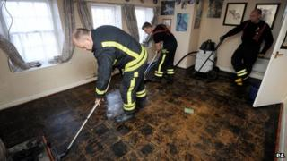 Firefighters clearing up inside one of the affected homes