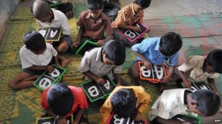 Schoolchildren with slates