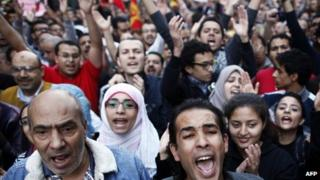 Protesters shout slogans against Mohammed Morsi's declaration in Cairo