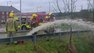 Fire crews pumping water in Ruthin