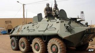 Islamists on an abandoned tank in northern Mali, August 2012