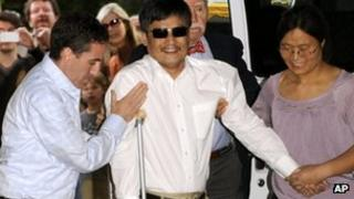 In this May 19, 2012 file photo, blind Chinese legal activist Chen Guangcheng arrives at Washington Square Village on the campus of New York University, in New York