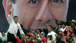 Enrique Pena Nieto waves to supporters (file image)