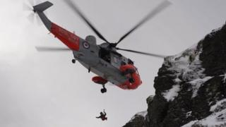 Winchman descending during the rescue