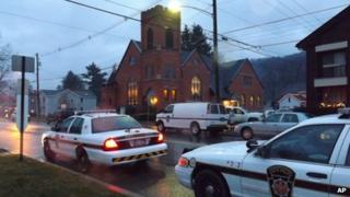 Police cars are parked at the 180-year-old First United Presbyterian Church of Coudersport 2 December 2012