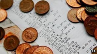 Supermarket till receipt with coins