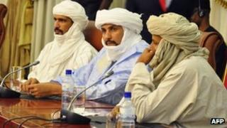 Algabass Ag Intalla (centre), leader of the Ansar Dine delegation, attends a mediation meeting with members of the Malian government and Tuareg rebels, hosted by Burkina Faso's president in Ouagadougou, 4 December 2012