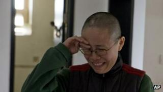 Liu Xia, wife of 2010 Nobel Peace Prize winner Liu Xiaobo, reacts emotionally to an unexpected visit by journalists at her home in Beijing, China, 6 December 2012