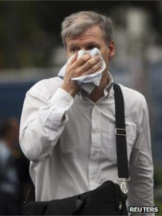 Man in Buenos Aires covers his face