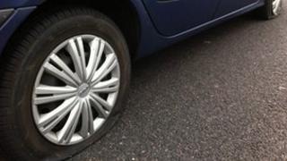 Slashed tyers on car in Leeds