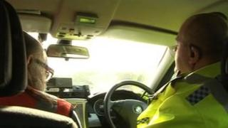 A lorry driver is given a ticket