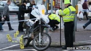Police and motorbike at crash scene