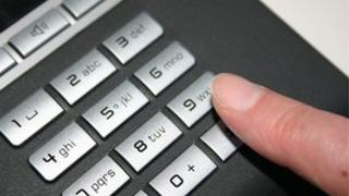 Man dialling telephone