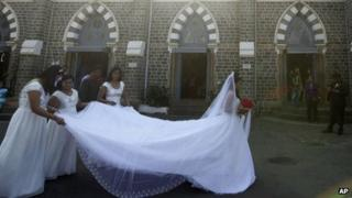 Indian bride Emilia D'Silva arrives at a church for her wedding in Mumbai on 12/12/12