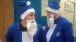 Portsmouth FC footballers Jon Harley and Johnny Ertl model the blue Santa suits