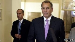 House Speaker John Boehner returns from talks at the White House 17 December 2012