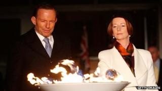 PM Julia Gillard (R) and opposition leader Tony Abbott (L) light a beacon to mark the Queen's jubilee on 4 June 2012
