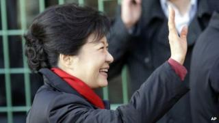 Presidential candidate Park Geun-hye waves after casting her ballot early on 19 December 2012